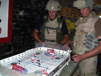 American Soldiers having fun playing Table Hockey in the Middle East